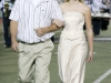 Paul Peterson walks his daughter, Michele Peterson, towards the homecoming court during the Crescenta Valley High School Home Coming Game. (Photo by Ed Hamilton / oct26, 2012)