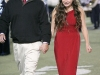 Phil Torres walks his daughter, Marina Torres, towards the homecoming court during the Crescenta Valley High School Home Coming Game. (Photo by Ed Hamilton / oct26, 2012)