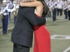 Carlos Alvares walks his daughter, Maya Alvarez, towards the homecoming court during the Crescenta Valley High School Home Coming Game. (Photo by Ed Hamilton / oct26, 2012)