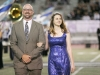 Roger Sondergaard, walks his daughter, Kaja Sondergaard, towards the homecoming court during the Crescenta Valley High School Home Coming Game. (Photo by Ed Hamilton / oct26, 2012)