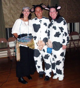 La Crescenta Woman's Club Halloween party chair Marilyn Wright, left, and second place costume winners Che and Molly Hwang as a pair of cows.