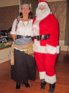 Party chair Marilyn Wright and Cathy Faddis as Santa