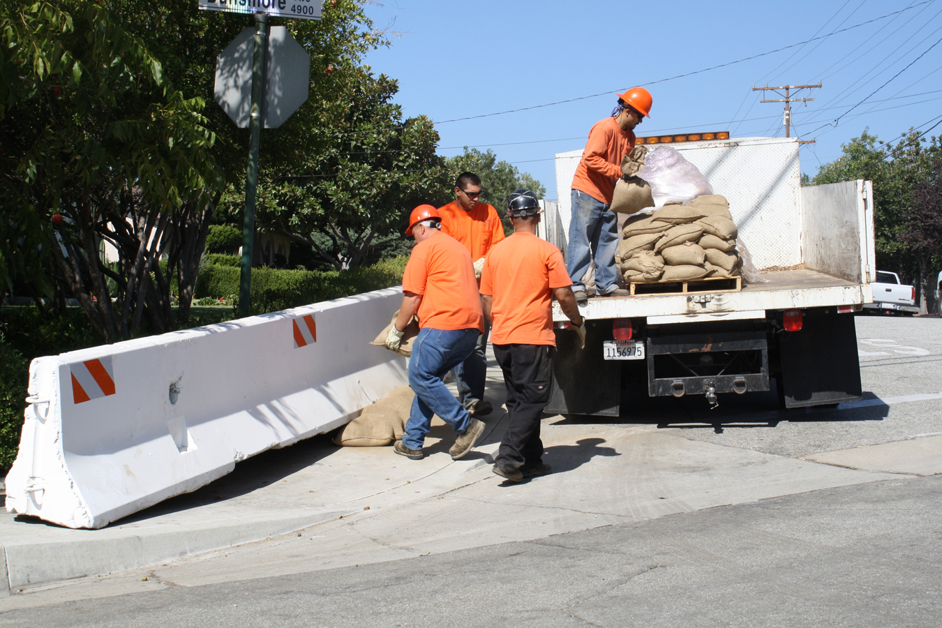 Photo By Mary O'KEEFE Glendale Public Works employees prepared for the worst just before the first post Station Fire rain storm. Workers placed K-rails and sandbags along several foothills  streets including this one on Dunsmore Avenue.