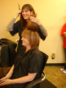 "Photo By  robin GOLDSWORTHY making the cut"" Jessie Ingels, owner of cutters, gives Youna Karlsson a trim."