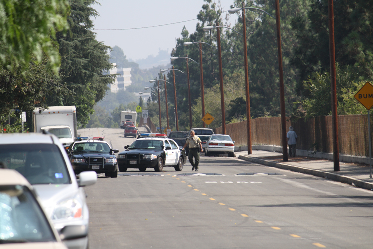 Photo by Mary O'KEEFE Arrest made» Crescenta Valley Sheriff deputies blocked off Altura Avenue about 2 p.m. on Tuesday while looking for a suspect.