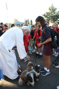 "All animals took part in Blessing of the Animals at Holy Redeemer Catholic School on  Oct. 2.  Pictured from left, ""Father Jack"" Foley,  Ace the bunny and Gabriel Buzzelli.  Photos by Mary O'KEEFE"