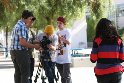 Photo by Mary O'KEEFE Matt Anderson, left, works with fellow filmmakers for a video on living a drug free life.