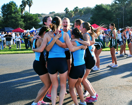 The CVHS girls cross country team members celebrate placing second at Mt. SAC last weekend.