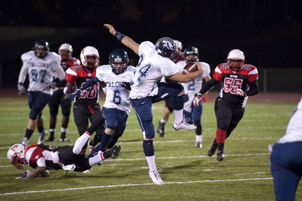 CVHS Falcon Harry Pessy makes an impressive vault over the defense on his way to a touchdown. Photos by Greg COOK