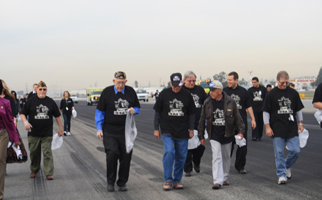 Veterans walked a runway at Bob Hope Airport to pick up the foreign debris that pose a danger to airplanes traveling the runways.