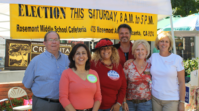 Candidates running for Crescenta Valley Town Council greeted community members at Sunday's Harvest Market.  From left, front row: Silvana Casalegno, Wendy Alane Smith, Robbyn Battles and Kim Mattersteig. From left, back row: Charles Beatty and Todd Thornbury.  Candidate not pictured: Dennis van Bremen.