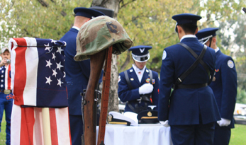 Crescenta Valley High School JROTC set the Missing in Action table at Two Strike Park as part of the Veterans' Day ceremony. Photo by Mary O'KEEFE
