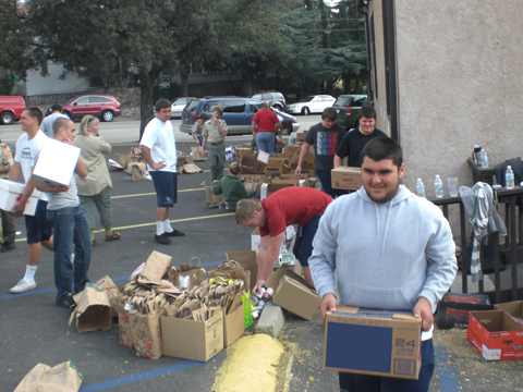 Boys from the Crescenta Valley High School football team showed up to lend a helping hand during the Scouting for Food event. Food was loaded into boxes and bags donated by local markets. Photo by James FLETCHER