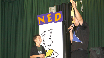Fremont Elementary School student Hunter Cuneo, third grade, reacted to what he thought was his prize during the NED assembly at his school. Photo by Mary O'KEEFE