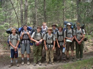 Photo sent by Beverly de LUCIA From left, front: Adam Wallace, Kevin O'Toole, Adam de Lucia, Ryan Wallace, Kevin Kussro, Matthew Susank and Connor Chavarria. Adult advisors in back row: Dr. Marty O'Toole and Roger Wallace. The Troop at JPL draws Scouts from many communities, the communities including of La Cañada, Pasadena, Glendale, Sunland and Sun Valley.