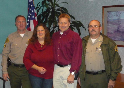 Outgoing CV Sheriff's Support Group president Lisa Dutton welcomes Leo Lesh as the organization's new president. Shown to the left of Dutton is Deputy Jeff Martin and to Lesh's right is Lt. Greg Sisneros.  Courtesy of the CVSSG