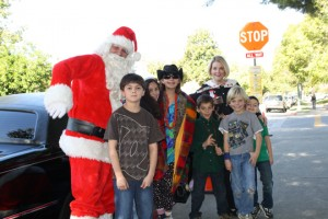 On Dec. 18, Fremont Elementary School students (right) were treated to a limo ride to In and Out for a hamburger and shake with Santa Claus and their principal Cynthia Livingston. The lucky students raised the most funds in the school's Sally Foster gift wrap fund raiser. They were surprised when they found not only Santa but their principal waiting at the limo. Livingston has been out of school for weeks recovering from a car accident. From left, Santa, Michael Sorokin, Faith Heggie, Anne Bonino-Britsch, Dylan Koch, Livingston, Michael Ruf and Dylan O'Meara.