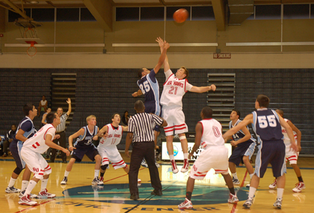 Seen here is the tip off of the championship game against Redondo Union at the Lahainaluna Invitational 2009. Though strong right through the third quarter, the Falcons lost to the Sea Hawks 52-47. Starting the final game were Adam Dassad, Christian Misi, Cole Currie, Coltrane Powdrill (jumping) and Nick Dragovich. Photo courtesy of Sandra DASAAD