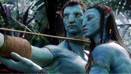 Neytiri (Zoë Saldana, right) teaches Jake (Sam Worthington) the skills he'll need to survive in Pandora.