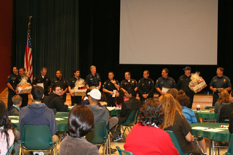 Clark Magnet High School PTA honored local firefighters and police at their Novemeber meeting. Photo by Mary O'KEEFE