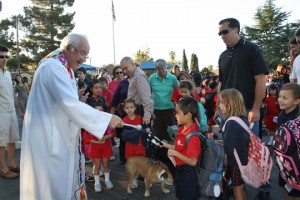 Father Jack Foley blesses the animals at Holy Redeemer Catholic School, just one of the many  events students share at the school.  Photo Mary O'KEEFE