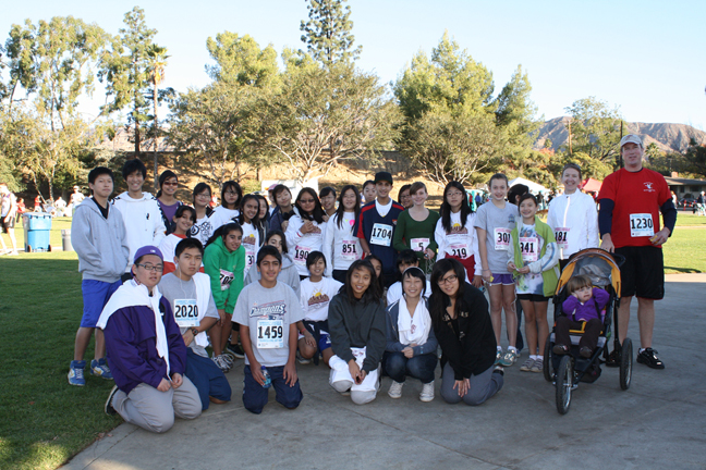 Rosemont Middle School Builders Club members were ready to run at the Thanksgiving's Day Run and Food Drive. Far right is James Mackey, teacher and mentor for Students Run L.A. Builder's Club mentor Laura Navaez-Rivera, not pictured, was at the run to support the club. Photos by Mary O'KEEFE