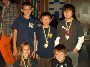 Mountain Avenue Elementary students show off their dog tags and medals at the 2009 MACK (Mountain Avenue are Committed to Kids) foundation Jog-A-Thon Award and Recognition Ceremony. Back row, from left, fourth graders Will Smiley, Eric Park and Steven Cha. Front row from left, two of the top five fundraisers for the school are fifth graders Mara Nieyst and Andrew Walsh.         Photo courtesy Skip McNEVIN
