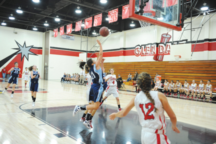 Photos by Leonard COUTIN  Catherine Davis goes up for a shot. Her late free throws helped seal a Falcon win over Glendale.