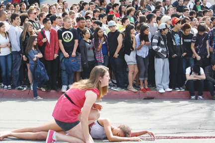 File photo  At a previous Every 15 Minutes presentation, students lined up on Ramsdell Avenue, watching the drama unfold as a girl kneels over a fatally injured friend. The program takes place today and tomorrow, in part outside Crescenta Valley High School.