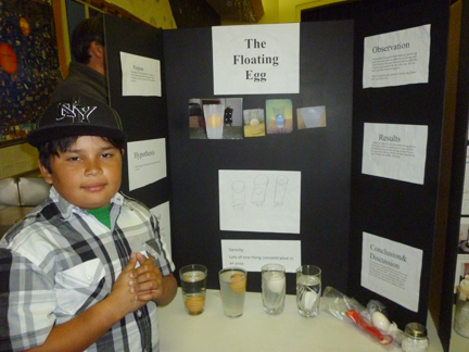Fourth grade student Jonathan Magna tests for properties of density.