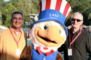 La Cañada residents Aaron Prince and John Loomis cheer on the U.S. Men's Olympic Water Polo Team with Sam Eagle, mascot of the 1984 Olympic Games in Los Angeles.