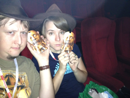Charly Shelton and Sabrina Walentynowicz with golden idol tickets to the Indiana Jones marathon at AMC Theaters.