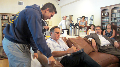 "Actor Andy Garcia signs a copy of ""The Godfather Trilogy"" for an admiring student."