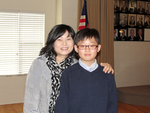 Student Curtis Yun, shown with his mother, won for grade level four, five and six.
