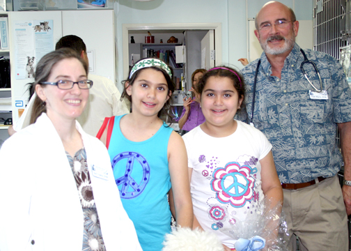 Photo by Natalie MAIER CVVH veterinarian Keri Franco DVM with open house visitors fourth grader Solange and sister Sharleese Eurodijian with (standing) veterinarian Thomas Black DVM.
