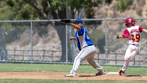 Photo by KC CHRISTOPH CSA first baseman Anthony Cabrera gets the ball just ahead of Nathan Longwell of La Cañada.