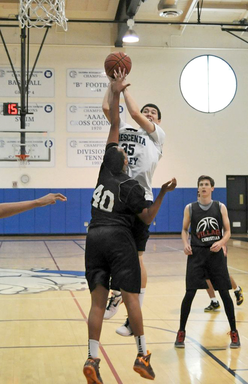 Photo by Dan HOLM Kevin Dinges goes for a layup against Village Christian on Tuesday. For more photos visit us online @ cvweekly.com/sports