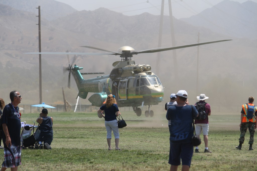 Photo by Michael YEGHIAYAN Attendees at Saturday's American Heroes Air Show watch as L.A. Sheriff's Air Rescue 5 lands at Hansen Dam.