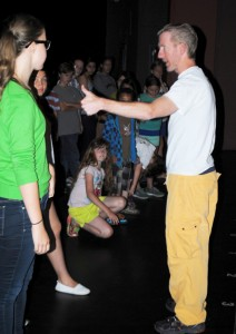 Quinn Kelly (left) talks to choreographer Paul Reid as Eloise Creith (kneeling) looks on.