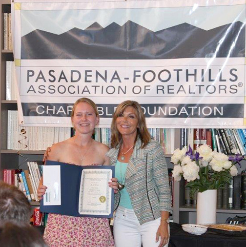 Realtor Lynnell Woodward of Dilbeck Real Estate Real Living, La Crescenta, presents a scholarship to student Rachel Albright.
