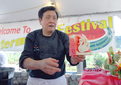 Celebrity Chef Joseph Poon, a spokesperson for the National Watermelon Promotion Board, serves up a carved treat.