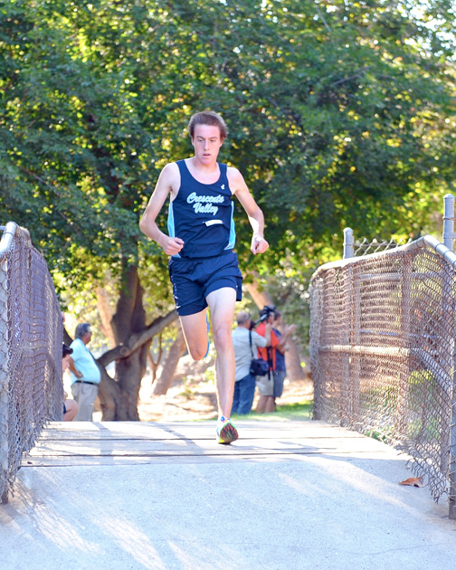 Photos by Leonard COUTIN Gabe Collison was ahead of the pack at the first mile mark on the bridge at CV Park.