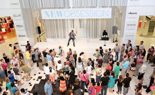 A crowd surrounded the stage in the Macy's court for the August fashion extravaganza.