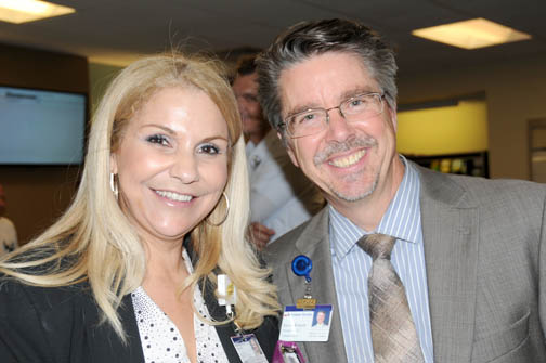 Nasly Zelaya, manager, Physician Relations Business Development with Kevin Roberts, GAMC president/CEO.