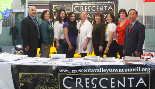 Photo by Mary O'KEEFE Hoping to capture the vote for CV Town Council are (from left) Harry Leon, Lisa Griffin, Kerri Lewin , Mariam Gabra Barnes, Kyle Studebaker, Krista Smiley, Cheryl Davis, Leslie Dickson and Dr. Young Suh at the Harvest Market.