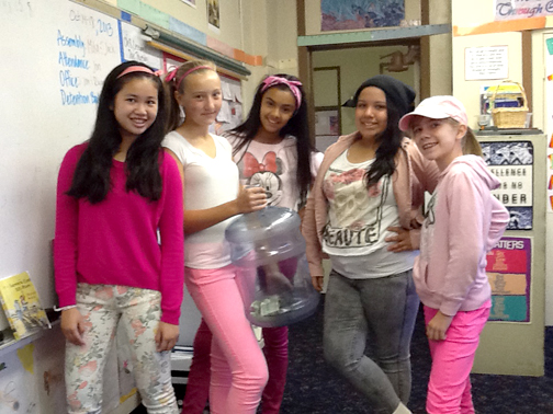 Holy Redeemer eighth graders (from left) Mika Butalid, Nicole Lewis, Kristina Flores, Sofie Gutierrez, and Sabrina Macy Mika, show off their pink free dress.