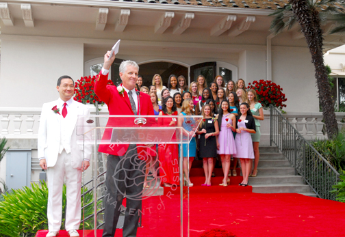Pasadena Tournament of Roses Association President R. Scott Jenkins holds up the envelope containing the names of the seven young women chosen for the 2014 Tournament of Roses Royal Court during a special ceremony at Tournament House in Pasadena on Monday, Oct. 6, 2013.