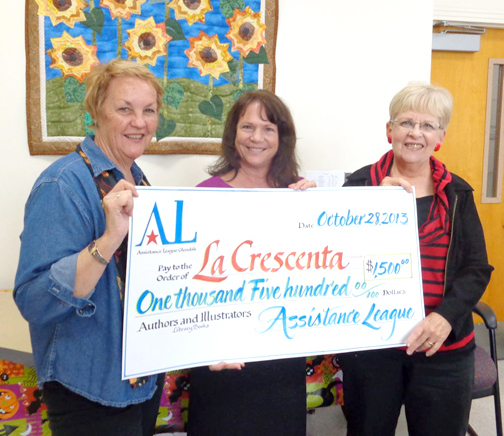 Photos provided by Karen SAUNDERS Karen Saunders, chairman of Authors and Illustrators, presents a check to Kim Bishop (center), principal of La Crescenta Elementary School, with the help of Karen Millman, president of Assistance League Glendale.