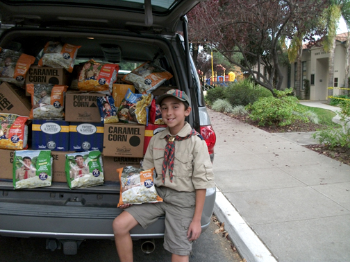 Photo by McKenna MIDDLETON Boy Scout Trevor Hall sits in his mom's van packed with the $2,000 worth of items he sold.