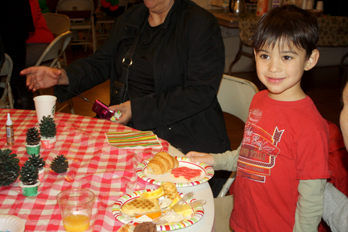 Though Josh Copi, 4, liked the crafts and the fire engine, he really liked the holiday cookies.